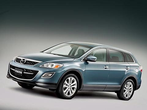 Mazda cx-9. В зависимости от комплектации на кроссовер ставят диски одного из двух видов, с обновлённым рисунком. Они обтянуты шинами размерностью 245/60 R18 и 245/50 R20.