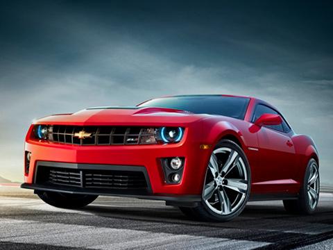 Chevrolet camaro zl1. Отличительными чертами «заряженного» купе Chevrolet CamaroZL1 стали ноздря накапоте (она чёрная независимо отцвета кузова), видоизменённая фальшрадиаторная решётка, переделанные бамперы иновые пороги.