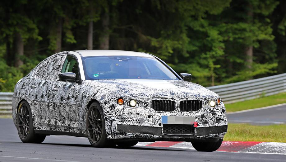 Bmw m5. Прорези воздухозаборников в переднем бампере и четыре патрубка выхлопной системы — вот что выдаёт в тестовом прототипе «горячую» версию BMW пятой серии.