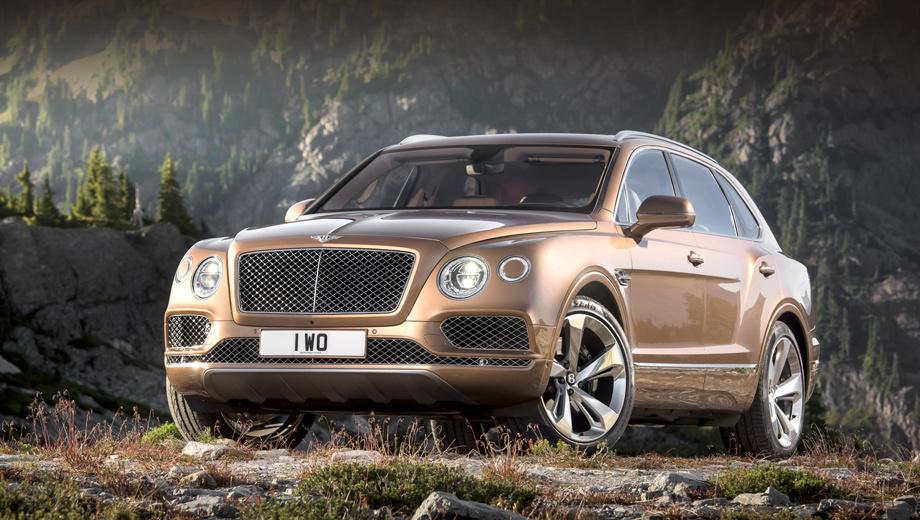 Bentley bentayga. Четыре круглые светодиодные фары и характерная форма решётки однозначно указывают на принадлежность семье Bentley. В центре наружных фар — кружок в цвет кузова. Он скрывает омыватель.