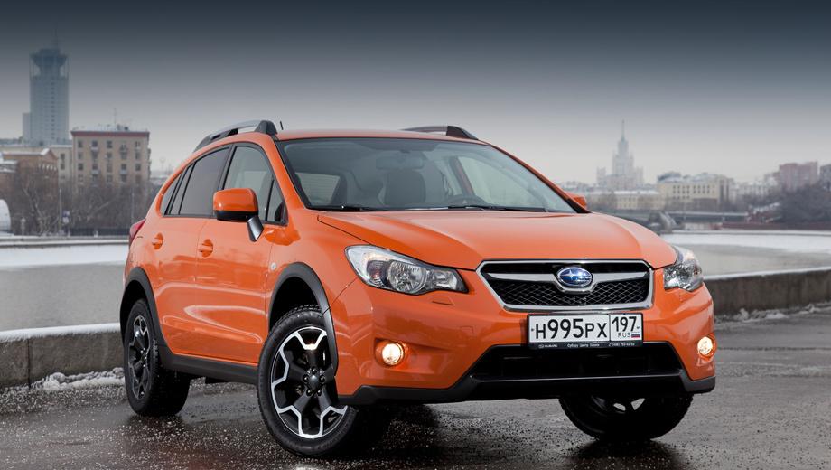 Subaru xv. Колёсные диски украшены заглушками в виде овального знака Subaru. Для кузова будет доступно два цвета: синий Deep Sea Blue Pearl и оранжевый Tangerine Orange Pearl.