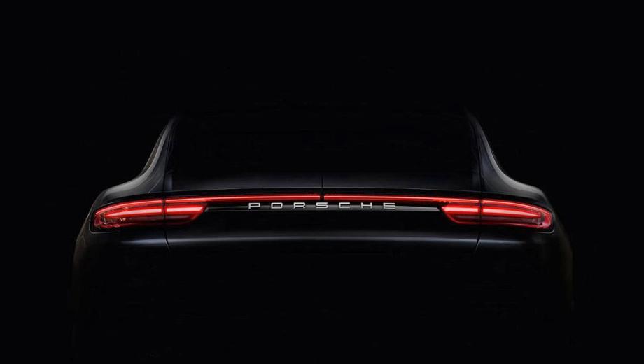 Porsche panamera. Задняя оптика перекликается по рисунку с фонарями обновлённого 911-го купе. Щель по центру — намёк на раскладное антикрыло.