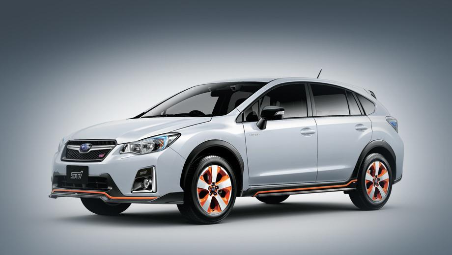 Subaru xv,Subaru xv hybrid,Subaru xv hybrid ts. Оранжевые акценты выделяют машину из череды собратьев. Дополняют их логотип STI на обрамлении противотуманок, тёмно-серая окантовка решётки радиатора, чёрные зеркала.