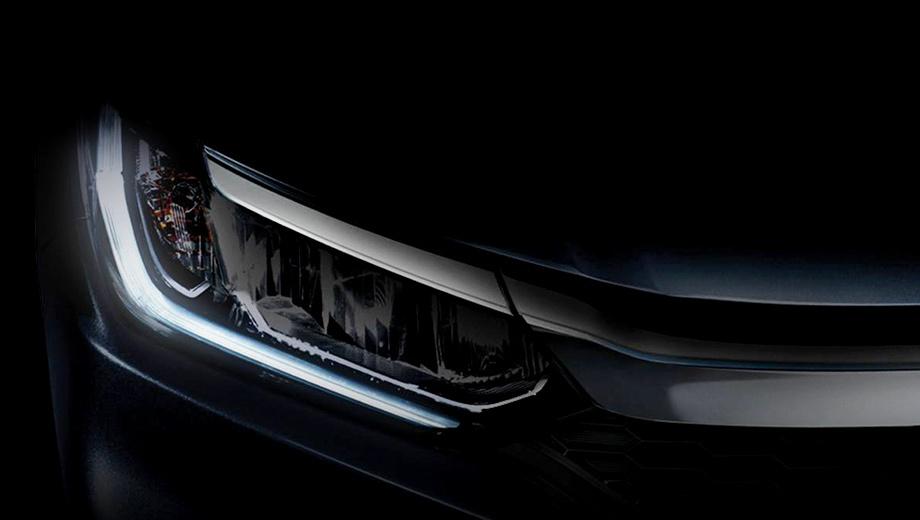 Honda city. Судя по тизеру, автомобилю отрядят новые оптику, решётку радиатора и бамперы, напоминающие оформление последнего поколения Сивика.