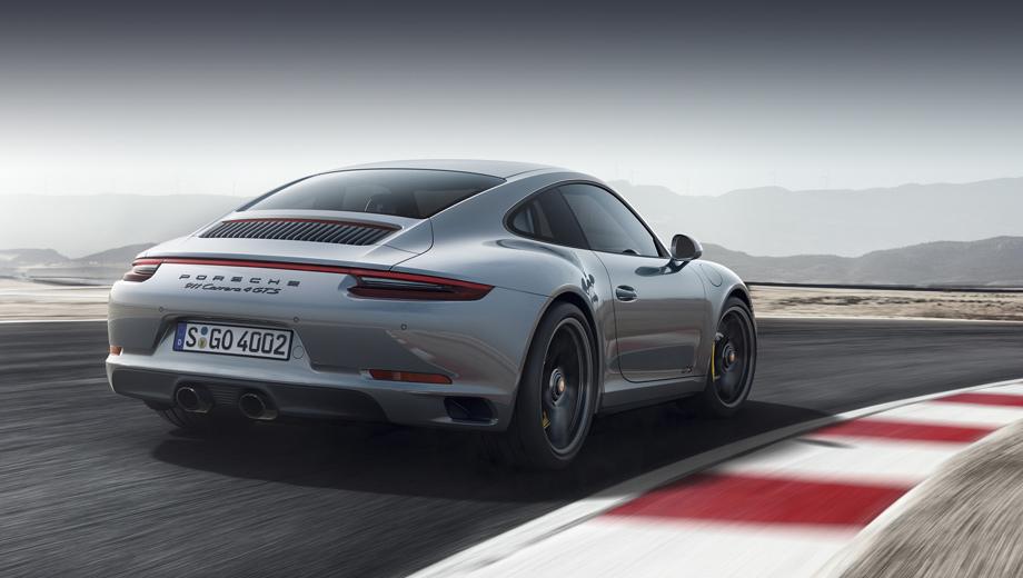 Porsche 911,Porsche 911 gts. Традиционно для GTS такая версия отличается от обычных 911-х чёрными элементами декора, от колёсных дисков и надписей, вплоть до выхлопных патрубков и тонированных фонарей.