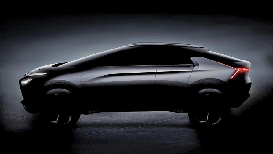 Mitsubishi e-evolution,Mitsubishi concept. Камеры вместо боковых зеркал, скрытые дверные ручки, огромные колёса... С предыдущим крупным концептом GT-PHEV новичка объединяют только эти концептуальные штучки.