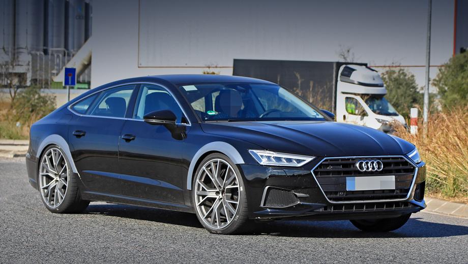 Audi rs7. Огромные колёса, кажется, не помещаются даже в грубо расширенные арки. Воздухозаборники в переднем бампере отличаются от стандартных для Audi A7.