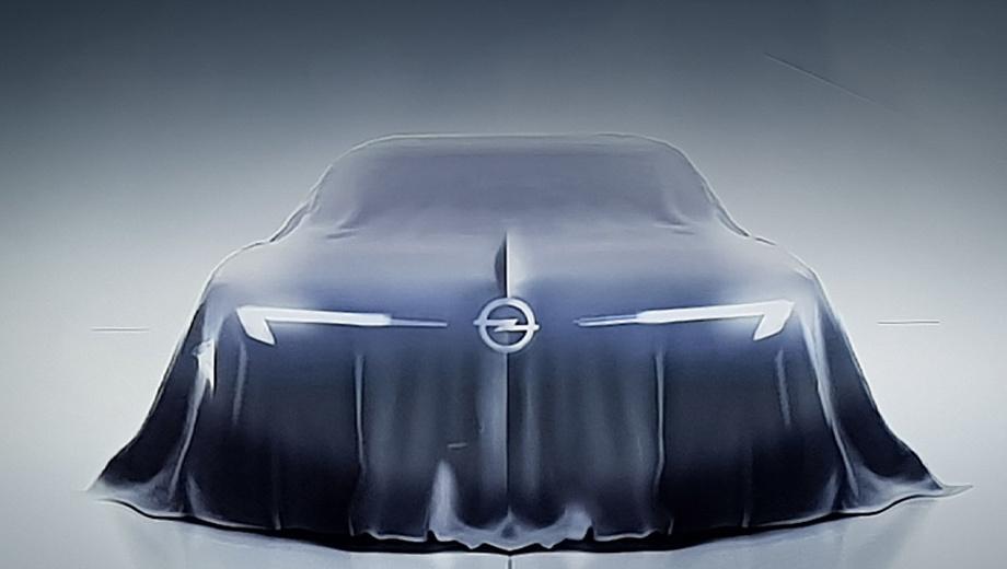 Opel concept,Opel gt. Это изображение было показано на экране во время технического семинара Tech Day в Рюссельсхайме. Бумеранги ходовых огней свойственны текущим моделям Опеля. Логотип нанесён поверх полотнища и скрепляет его, будто занавес. Наружных зеркал, как водится, нет.