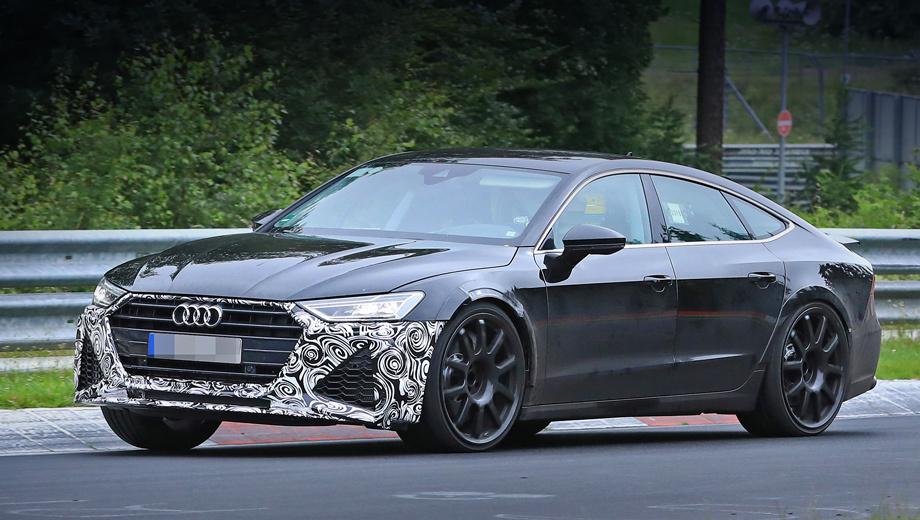 Audi rs7. Прежде на кузове не было вообще никакой маскировки. Её появление на носу говорит, что передний бампер близок к серийному. Сквозь стёкла можно разглядеть, что на месте переднего пассажирского и задних сидений смонтирован каркас безопасности.