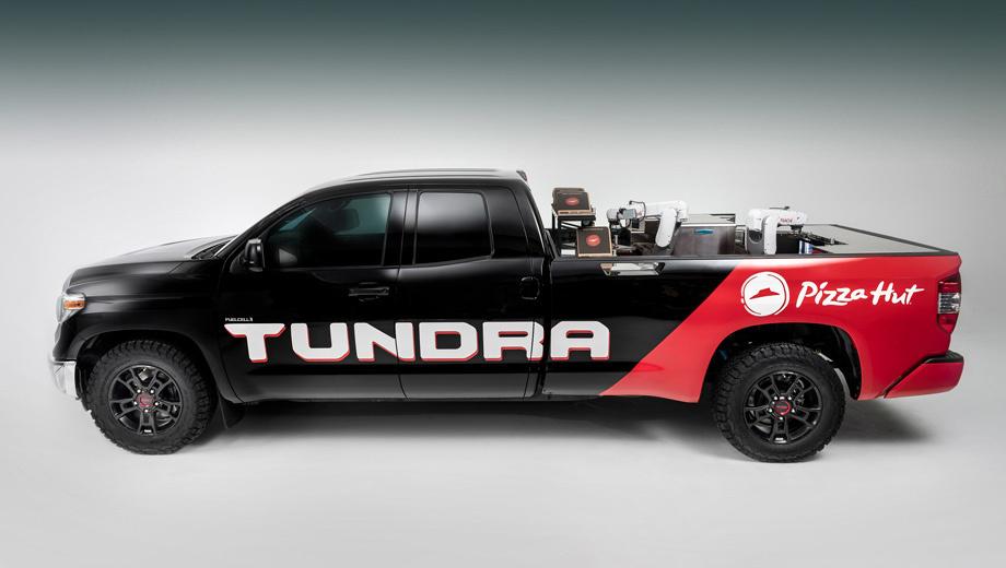 Toyota tundra. Обычная Tundra была разобрана практически до голого шасси и собрана заново. Проект был выполнен американским автоспортивным техническим центром Тойоты MTCI в сотрудничестве с компанией Nachi Robotic Systems и рестораном Pizza Hut в Плано (Техас).