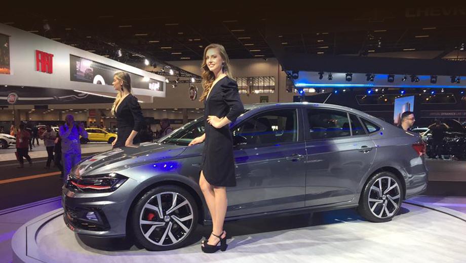 Volkswagen polo,Volkswagen virtus,Volkswagen polo gts,Volkswagen virtus gts. Декорации на GTS-версии Виртуса довольно скромны: красные полоска на носу и окантовки дефлекторов вентиляции да селектора «автомата», такого же оттенка прострочка на креслах и руле.