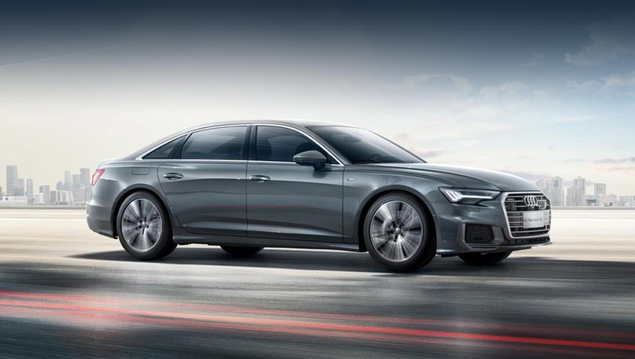Audi a6. Вся прибавка длины пришлась на заднюю дверь, и надо сказать, что она не бросается в глаза, если только не поставить простую и удлинённую версии рядом.
