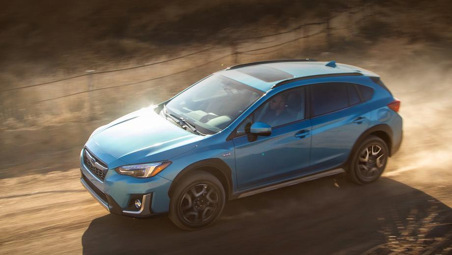 Subaru xv,Subaru crosstrek,Subaru crosstrek hybrid,Subaru crosstrek phev,Subaru xv hybrid,Subaru xv phev. Внешне гибрид отличается серебристым покрытием элементов решётки, переднего бампера и порогов, синими кольцами в фарах, уникальным цветом кузова Lagoon Blue Pearl, 18-дюймовыми колёсами, значками Plug-In Hybrid на пятой двери и передних крыльях.
