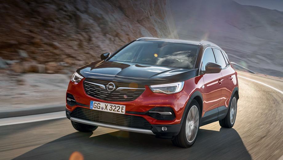 Opel grandland x. Внешне гибрид отличается от стандартного Грандленда разве что чёрным капотом (этой опции ещё нет в каталоге) да дополнительным лючком по левому борту, где прячется зарядный разъём на 3,3 или 6,6 кВт.