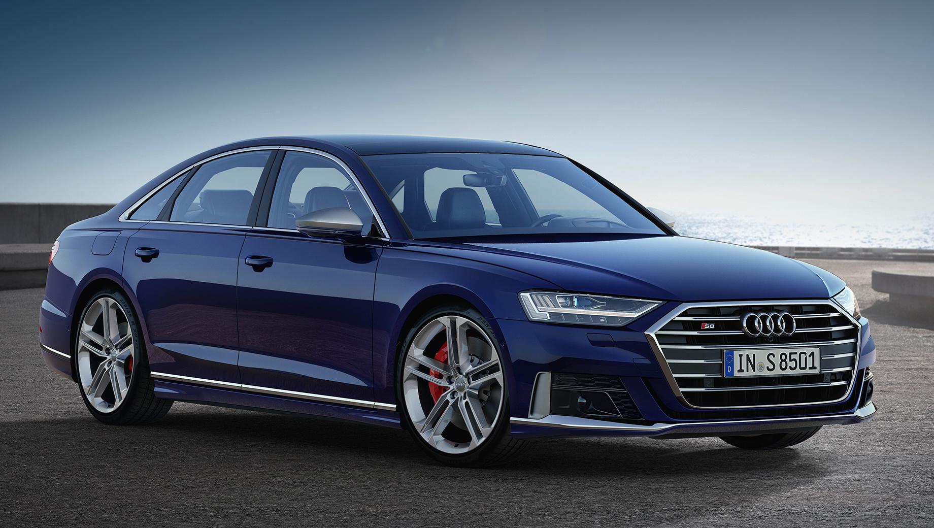 Audi s8. «Эска» разменивает сотню за 3,8 с, максималка ограничена электроникой — 250 км/ч. «В базе» идут 20-дюймовые диски «пять двойных спиц», за доплату в 119 300 рублей есть колёса на дюйм больше.