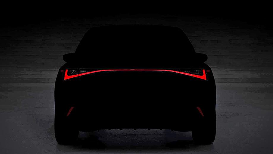 Lexus is. Краткое описание к первому тизеру гласит: Lexus IS «облачился, чтобы привести в трепет» весь сегмент. Под светодиодными фонарями в виде непрерывной полосы виднеется спортивный диффузор. Аналогично оформлена корма у Лексуса UX.